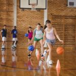 Kids run beginner's drills they learned from Backyard Fun Zone on a basketball court