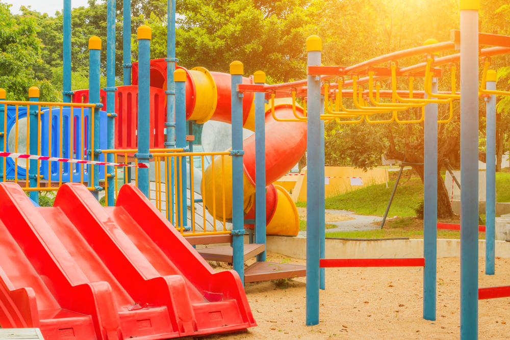 A children's playground on a sunny day sits as Backyard Fun Zone informs consumers how to go about purchasing a swingset for their home